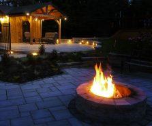 Backyard landscaping at night