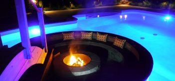 Fire pit inside a backyard swimming pool
