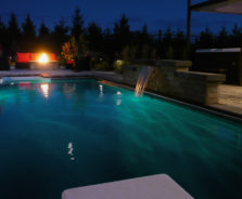 Pool water feature at night in Ottawa
